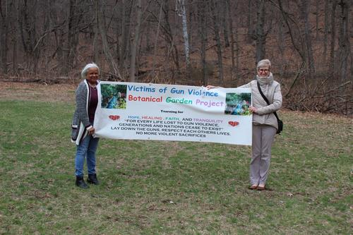 Marlene Miller-Pratt, left, who lost her son to gun violence, and Colleen Murphy-Dunning, director of the Urban Resources Initiative, stand together at the future site of New Haven's Botanical Garden of Healing in Dedication to Victims of Gun Violence.