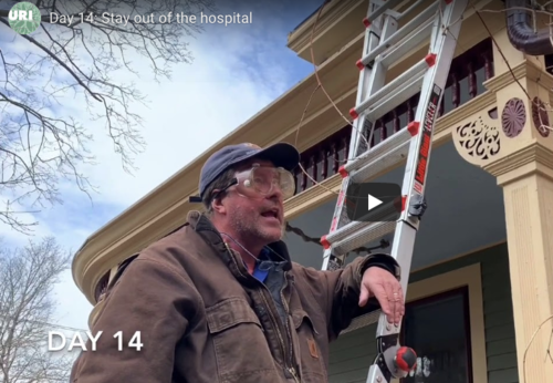 Screenshot of man leaning on ladder