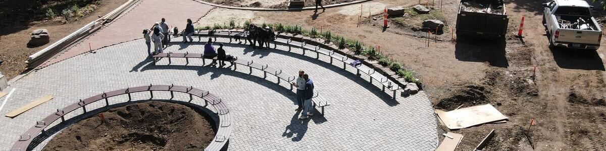 aerial view of people sitting on benches in the new garden