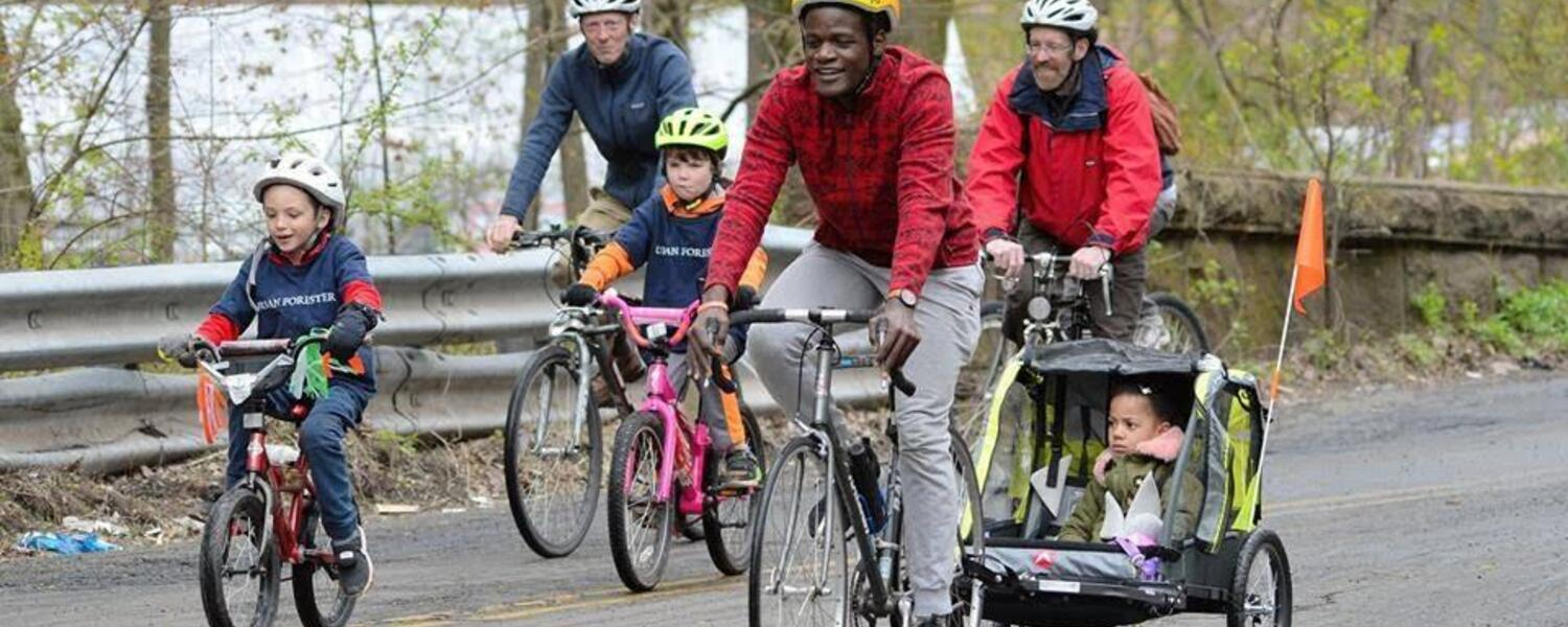 Adults and kids riding bikes