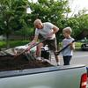 John and Ryan unloading mulch and compost from the truck.