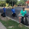 Three cleanup volunteers