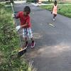 Child sweeping pathway
