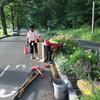 Volunteers cleaning median garden bed