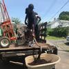 Volunteer scooping mulch