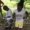 Child with garden snake