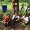 Kids in cleaned garden bed