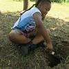 Child digging a hole in the park