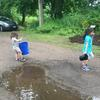 Kids carrying buckets