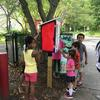 Kids painting the lending library box