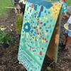 Children painting community garden sign