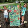 Kids showing their painted sign