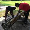 Volunteers painting bench