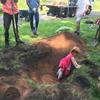 Child playing in hole
