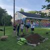 Volunteers digging a hole
