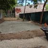 Spread out stone dust in garden