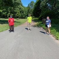 One volunteer and two interns along the central path in Beaver Ponds Park