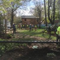 Volunteers rake leaves at Shepard and Huntington