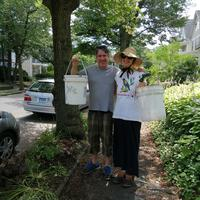 Susan and Chris with their watering buckets!