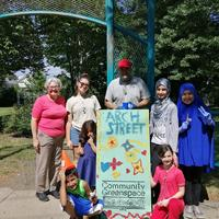 Group picture with the decorated Arch Street sandwich/sign board!