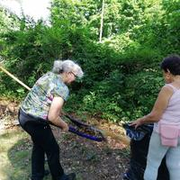 Cindy and Josefina cleaning up leaves at Arch Street!