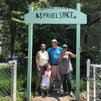 Volunteers with Shepard Street sign