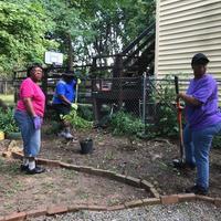 Three volunteers in garden