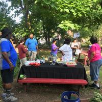 Volunteers chatting with food
