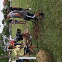 Volunteers digging hole